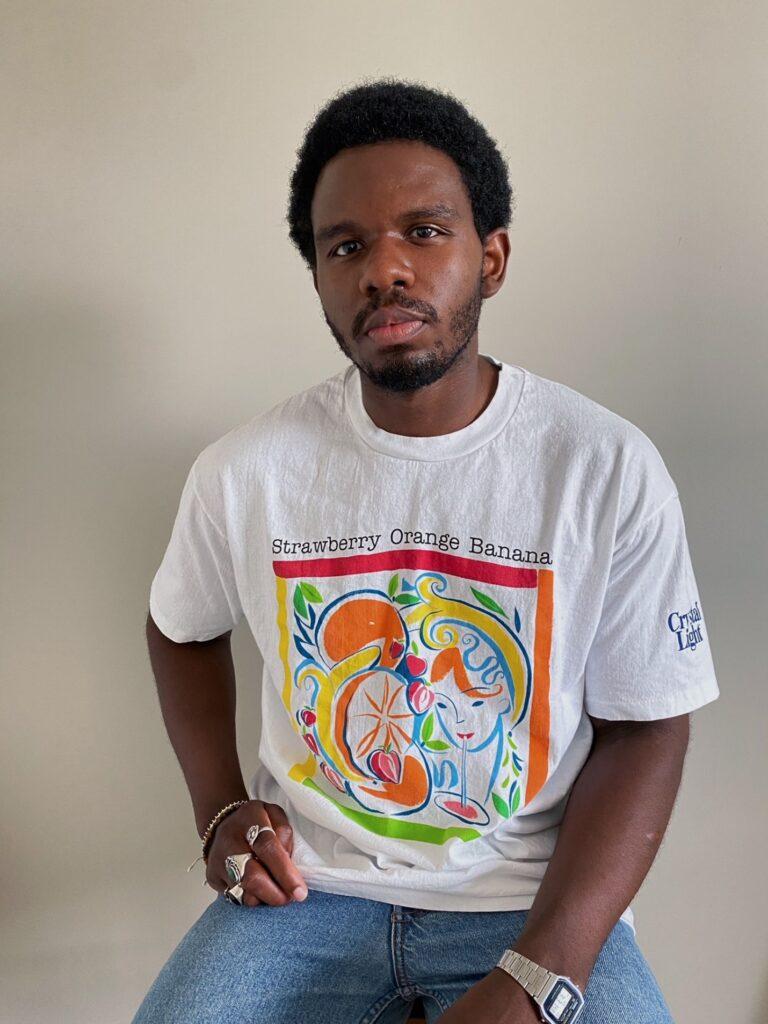 David styling white t-shirt with neon fruit symbols