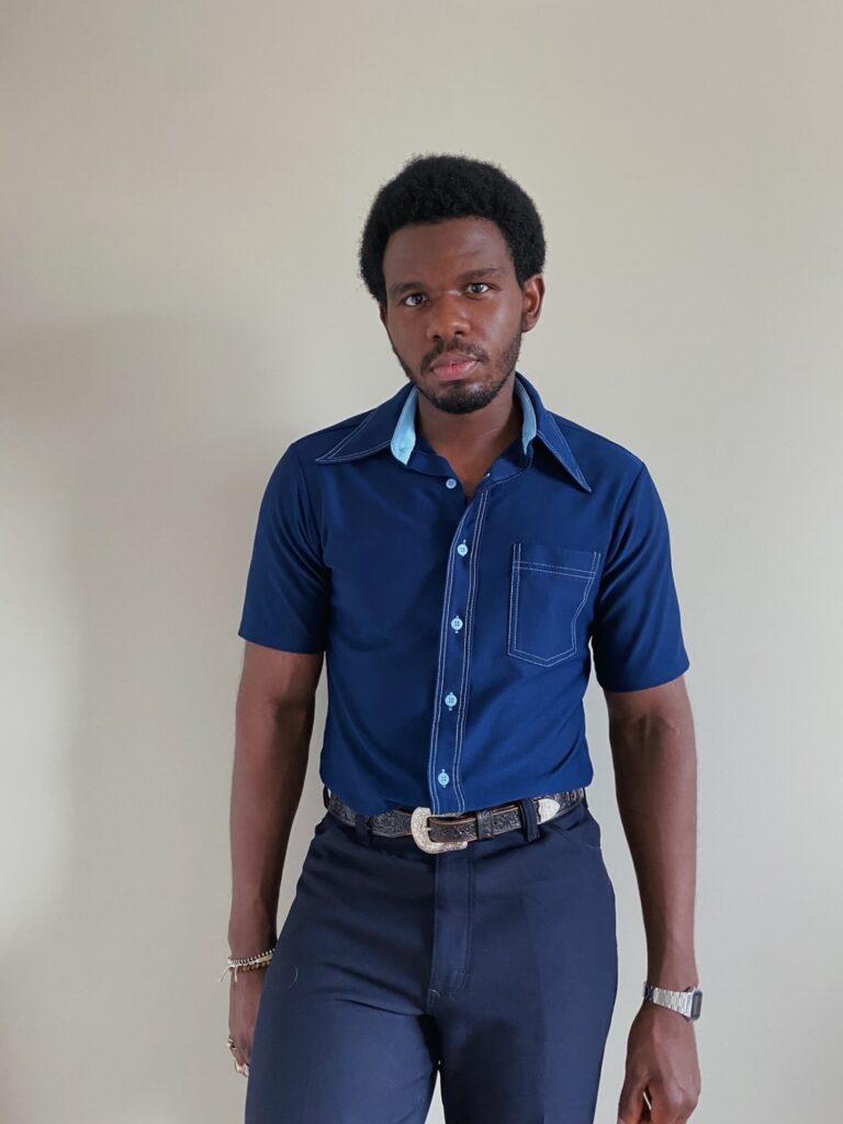 David styling bold blue collared short sleeve shirt