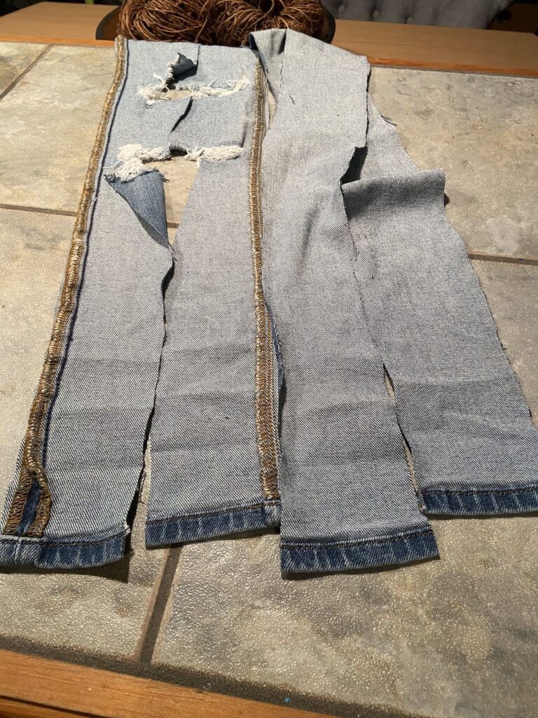 Cut the jeans into 4 strips